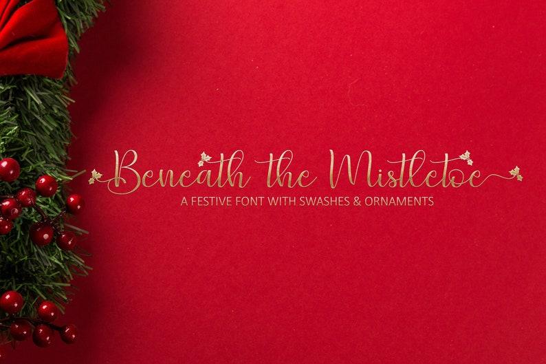 Beneath the Mistletoe font download Christmas font image 0