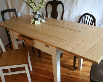 """Dining table """"Mücke Natural"""" in oak style with lapel parts"""