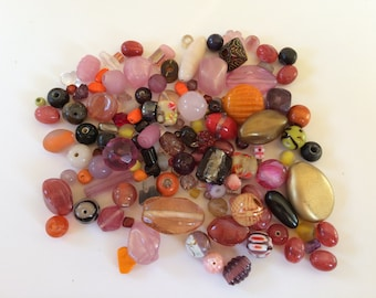 Assorted orange gold pink and maroon glass beads 94g