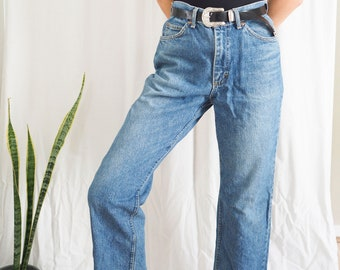 vintage lee denim high waisted dark blue jeans with raw hem