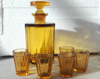 Antique glass bottle vintage with six (6) yellow glass shotsYellow Crystal Cut Glass Bottle