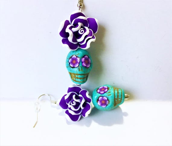 mejor valor precio inmejorable mejor precio para Azúcar azul calavera púrpura del polímero flor aretes