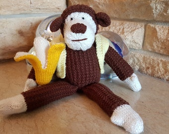 Hand Knitted Cheeky Monkey Toy with Giant Banana