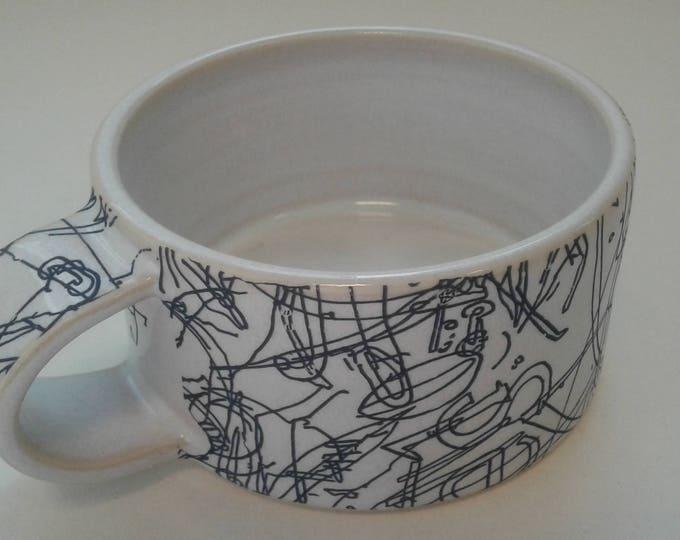 Short ceramic mug by Gosia Wlodarczak in collaboration with Maria Lieberman