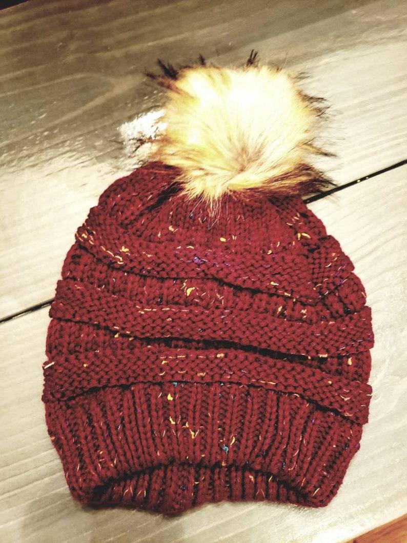 Slouchy knit pom pom hat
