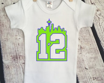 bd3318dad Seahawks 12th man newborn Seattle football NFL millennial Newborn  inappropriate Funny Adorable Baby Onesie Snarky Gift Free Shipping