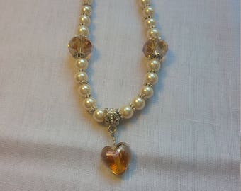 Necklace with champagne lampwork heart pendant, crystals and pearls.