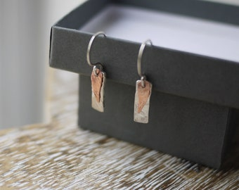 Silver and Copper dangle earrings with textured finish handmade