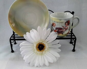 Antique Child's Cup and Saucer Set, ''The First Lesson'', Germany