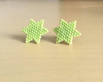 Green star shaped earrings