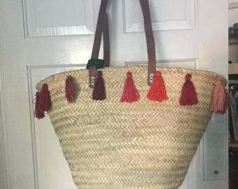 French shopping basket with red tassels