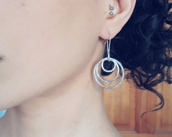 Earrings, drop, with three hammered dancing hoops in sterling silver