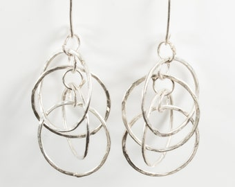 Earrings, drop, with four hammered dancing hoops in sterling silver