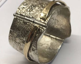 Bangle, shackle style in 9ct Gold and Sterling Silver with organic texture and accent