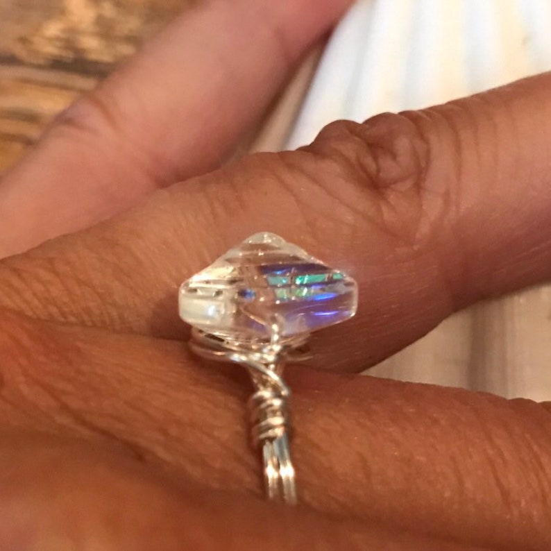 Wire wrapped clam shell glass ring