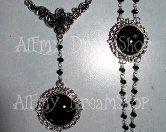 Bracelet and necklace with hand-colored black cameo