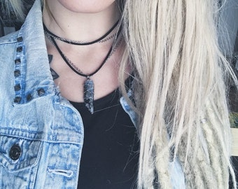 Necklace chain and black suede with electric blue kyanite hand wrapped Bohemian style.