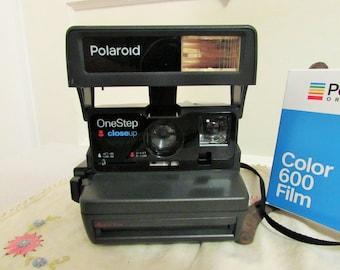 Polaroid One Step camera with film