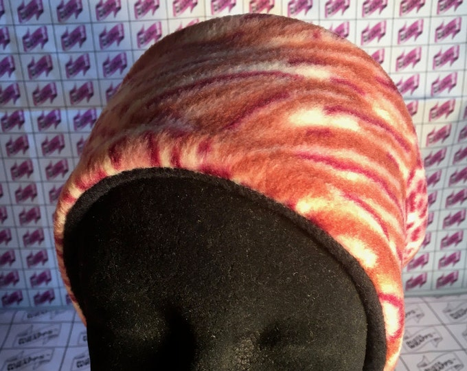 Bustawrapps are head wraps that cover the ears and forehead during those cold and windy winter months. Large-Xlarge, Rectangular shape.