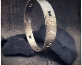 Handmade sterling silver butterfly cutout bangle with a natural inspired bark texture