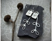 Sterling silver handmade pressed flower earrings with silver leaves