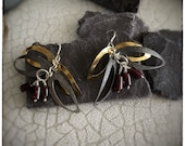 18ct, silver and oxidised silver dangly leaf earrings with tube garnet beads. Handmade textured light weight leaves cascading drop earrings