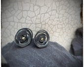 Oxidised sterling silver swirl unique stud earrings with 18ct yellow gold centres