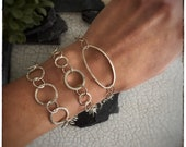 Hammered handmade sterling silver circle and oval link bracelets, inspired by trees and bark uniquely made by hand