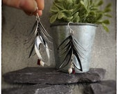 Stunning oxidised blackened silver dangly leaf earrings handmade and textured with red garnet tube beads and fresh water white pearl beads