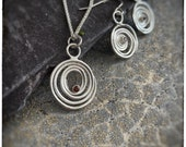 """Handmade sterling silver melted spiral swirl pendant on an 18"""" chain and drop dangly earrings with red round garnets set"""