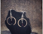 Hammered sterling silver crescent moon earrings with red garnets