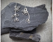 Mismatched sterling silver handmade flower dangly drop earrings with silver leaves