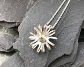 7 petal sterling silver flower pendant with 18ct yellow gold centre