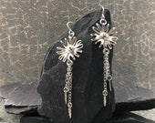 Sterling silver flower earrings with dangly petals