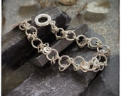 Circle chain link sterling silver handmade short bracelet, multiple bubbles and hoops with a T bar clasp, 7 inches long