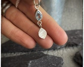 Sterling silver handmade leaf pendant with a sky blue faceted pear stone in a rub over setting 8 x 5mm on a 18 inch sterling silver chain.