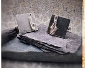 Silver square cufflinks with coastal wave melted detail