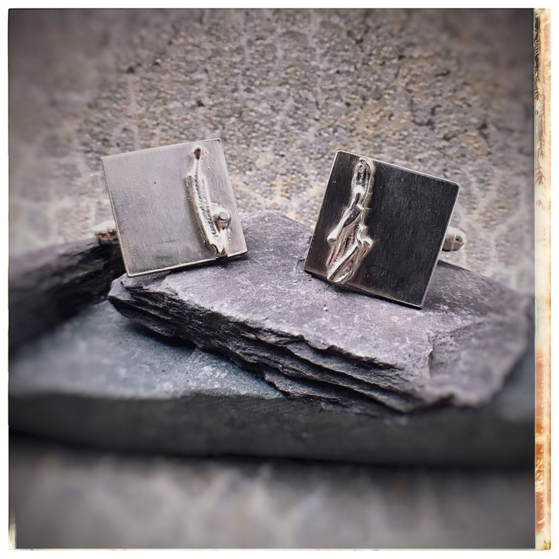 Silver square cufflinks with coastal wave melted detail image 0