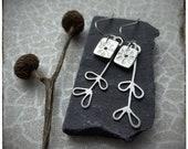 Sterling silver handmade pressed flower earrings with silver leaves