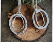 Hammered handmade sterling silver interlocking chunky circle hoop pendants on an 18 inch sterling silver chain