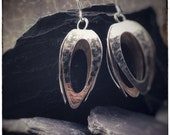 Large sterling silver pod earrings with black and silver pattern