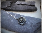 Sterling silver oxidised black melted swirl pendant with 18ct yellow gold centre