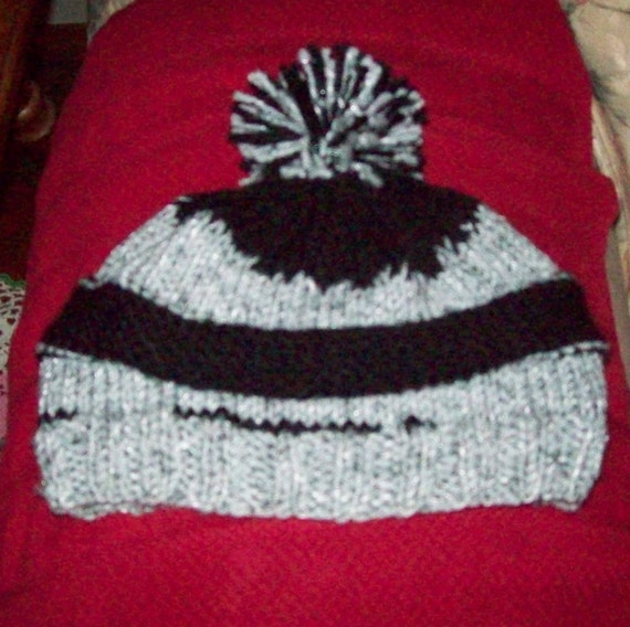 ad2c8c37e Hand Knitted Grey and Black Beanie with Pom Top Raiders Colors