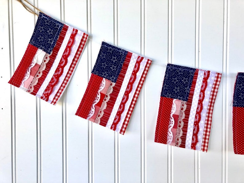 Handmade 4th of July patriotic Star Spangled Banner Garland. Come be inspired by 4th of July Tablescapes, Patriotic Decor & USA Finds: Happy Birthday, America in case you're in the mood for American flag and red, white, and blue festive finds.