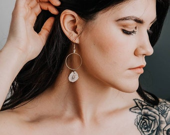 Gold hoops with dangling antler accent