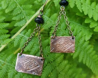 Handmade etched copper earrings.