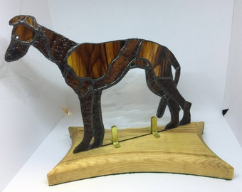 greyhound stained glass, on a oak base with green felt so it will not scratch anything