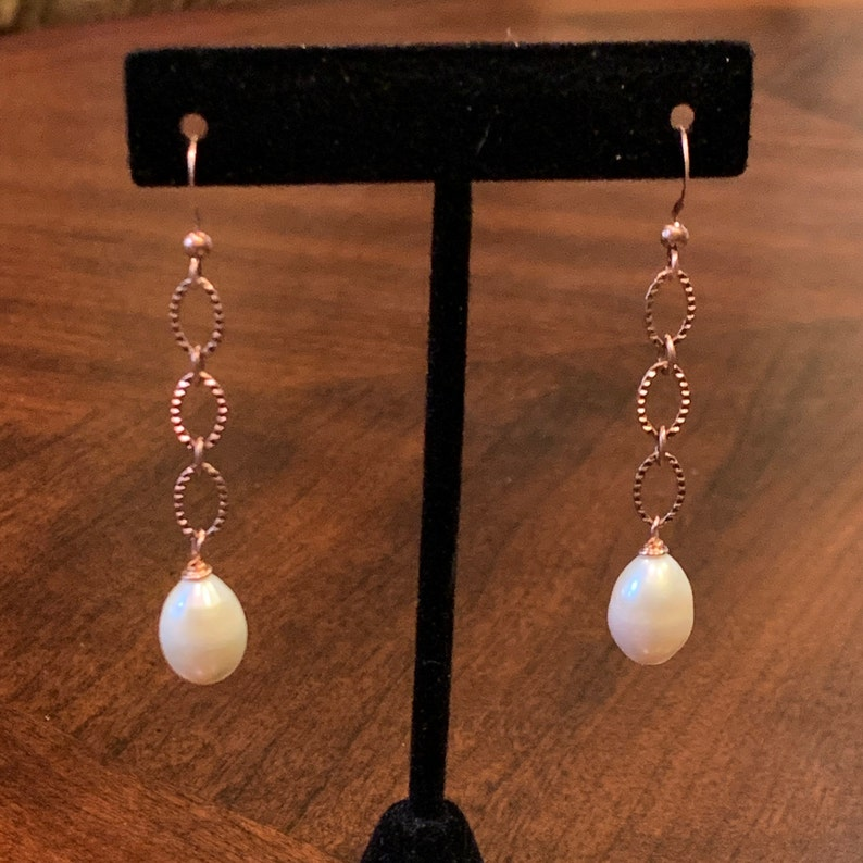 Freshwater white pearls and antique copper plated chain earrings.