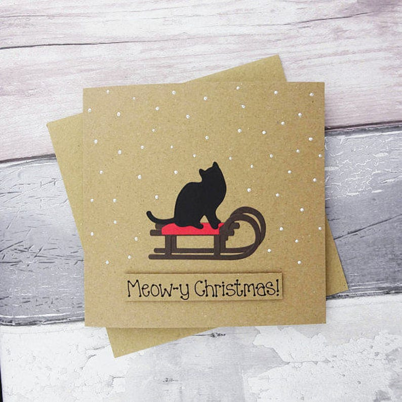 Cat Christmas card Black cat on a sled Sleigh Cat in the image 0