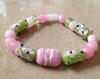 Pink and green glass beaded stretchy bracelet